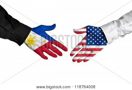Philippines and United States leaders shaking hands on a deal agreement