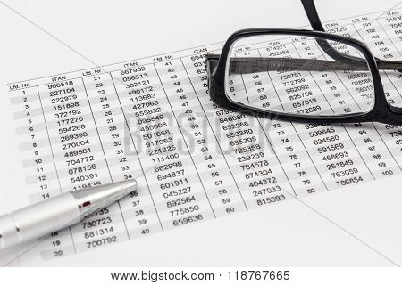 Glasses ballpoint pen and TAN list for online banking