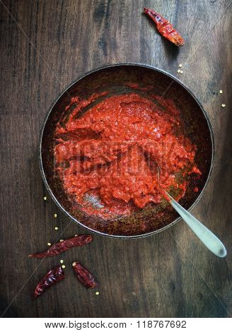 Harissa - a middle eastern hot red chili pepper paste. View from above.