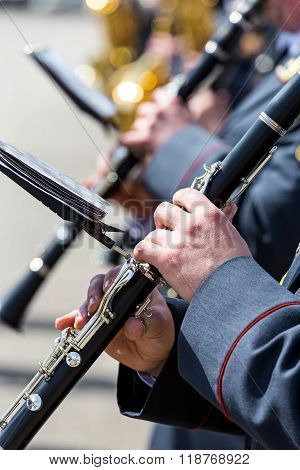 Musicians In Military Orchestra Playing On Clarinet