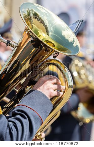 Closeup View Of Brass Tuba In Hands Of Musician