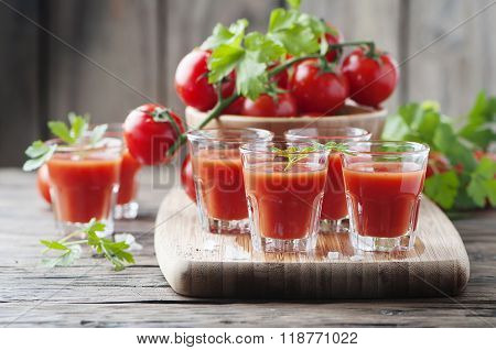 Bloody Mary Cocktail On The Wooden Table