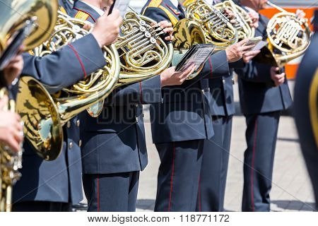 Military Musicians With French Horns At Street Concert