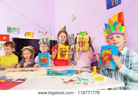 Kids show their crafts in creativity class