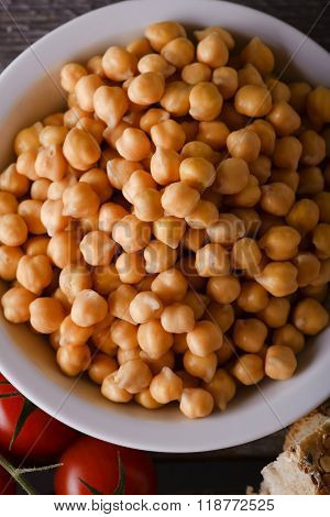 Bowl Full Of Chickpeas On Old Wooden Board
