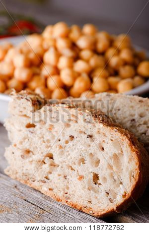 Detail Of Wholewheat Bread In Front Of Bowl With Chickpeas