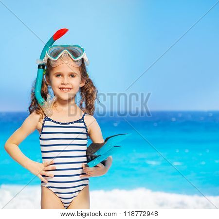 Funny litter diver with her diving equipment