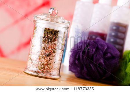 Jar With Bath Salt Askew Placed On Wooden Board