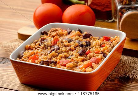 Mexican rice with black bean, corn, paprica and tomatoes.