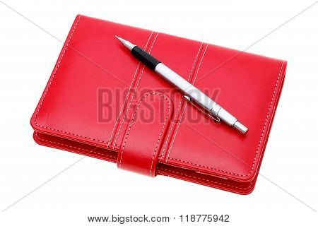 leather notebook and ballpoint