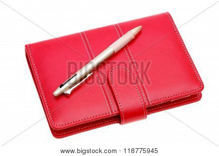 leather notebook and ballpoint pen
