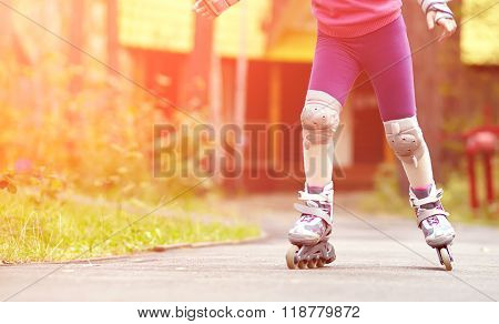 child rollerblading outdoors