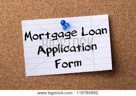Mortgage Loan Application Form - Teared Note Paper Pinned On Bulletin Board