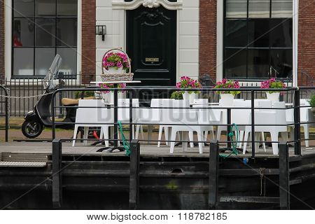 Small Cafe On The Waterfront Near Spaarne River In Haarlem, The Netherlands