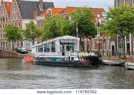 Tourist Boat On The Waters Of Spaarne River In Haarlem, The Netherlands