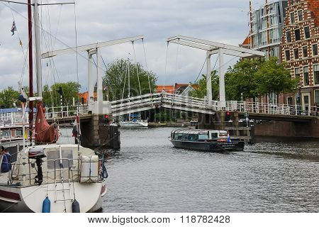 Pleasure Boat With Tourists Sails Under The Drawbridge In Haarlem, The Netherlands