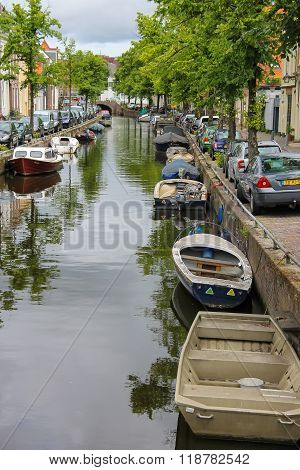 Narrow River Channel In The City Centre Of Haarlem, The Netherlands