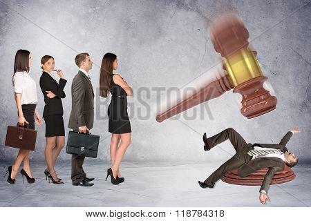 Inscribed gavel hitting businessman