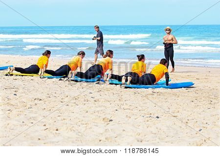 VALE FIGUEIRAS, PORTUGAL - August 22 2014: Surfers doing excersises on the famous surfers beach Vale Figueiras in Portugal
