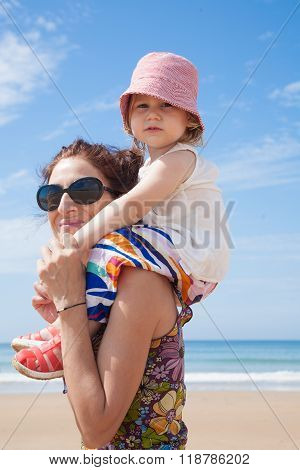 Baby On Mother Shoulders