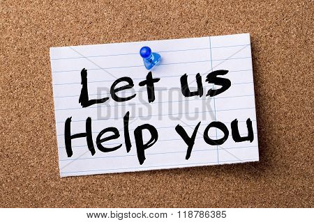 Let Us Help You - Teared Note Paper Pinned On Bulletin Board