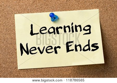Learning Never Ends  - Adhesive Label Pinned On Bulletin Board