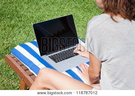 Woman Typing Laptop On Mat Deckchair