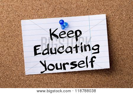 Keep Educating Yourself (key) - Teared Note Paper Pinned On Bulletin Board