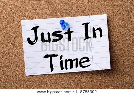 Just In Time - Teared Note Paper Pinned On Bulletin Board