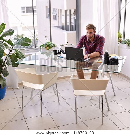 square shot of a businessman busy working at his desk