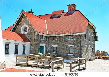 FIRE ISLAND, NY - MAY 23, 2015: Fire Island Lighthouse Keepers Quarters. The keepers quarters now house the gift shop.