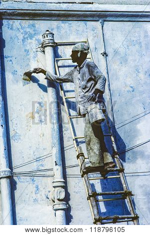 Local Painter Paints The Old Wall In The Typical Blue Color