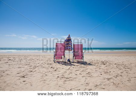 Two Lonely Chairs Looking At Ocean