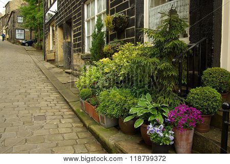 Haworth, England - June, 2013: Traditional English Garden In Front Of House In The Village Of Hawort