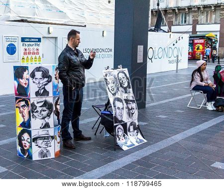 Street Artists On Leicester Square, Popular Place With Cinemas, Cafes And Restaurants. London. Uk