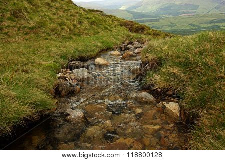 Scotland, West Highlands (ben Nevis, Near Fort William): View From The Mountain. A Mountain River Fl