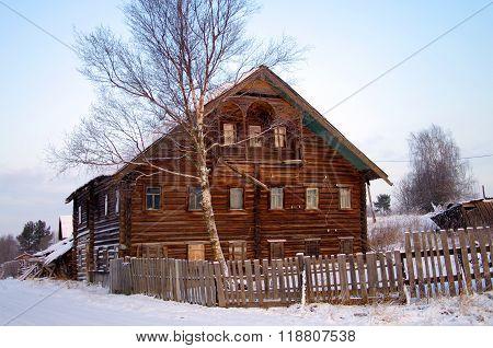 Kosmozero, Karelia, Russia - January, 2016: Two-storey Wooden House In The Village Of Karelia