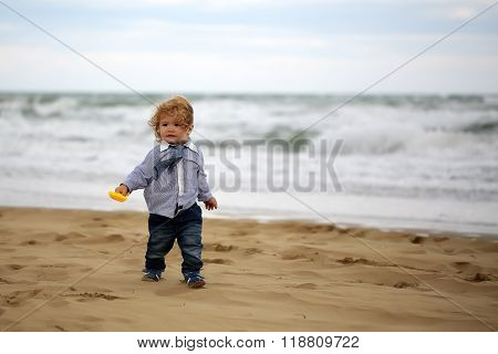 Cute Baby Boy On Beach