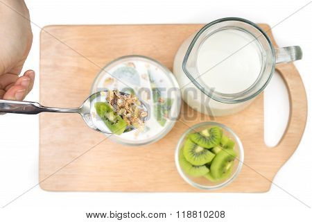 Breakfast, Eating Cereal, Pick Up Spoon, Scoop Cereal With Fresh Kiwis And Milk, Ready To Eat.