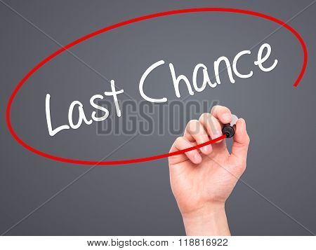Man Hand Writing Last Chance With Black Marker On Visual Screen
