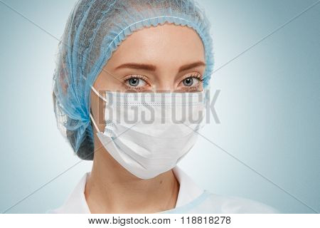 Young Woman Doctor Or Nurse In Cap And Face Mask.