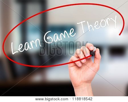 Man Hand Writing Learn Game Theory With Black Marker On Visual Screen