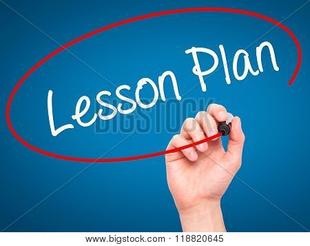 Man Hand Writing Lesson Plan With Black Marker On Visual Screen