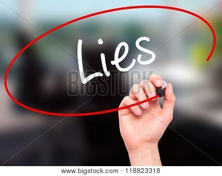Man Hand Writing Lies With Black Marker On Visual Screen