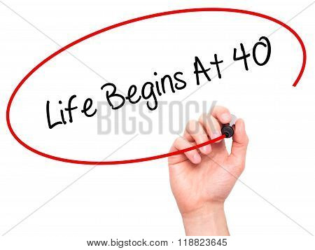 Man Hand Writing Life Begins At 40  With Black Marker On Visual Screen