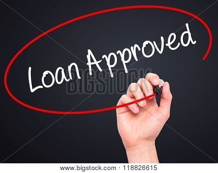 Man Hand Writing Loan Approved With Black Marker On Visual Screen