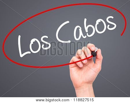 Man Hand Writing Los Cabos With Black Marker On Visual Screen