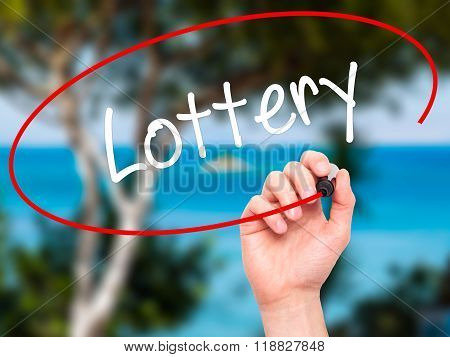Man Hand Writing Lottery  With Black Marker On Visual Screen