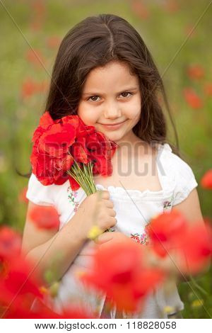 Happy girl with poppies.