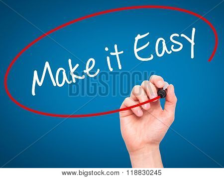 Man Hand Writing Make It Easy With Black Marker On Visual Screen